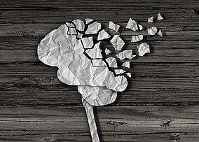 Illustration eines Gehirns das auseinander bricht